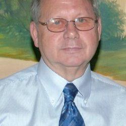 James E. Walker, age 74